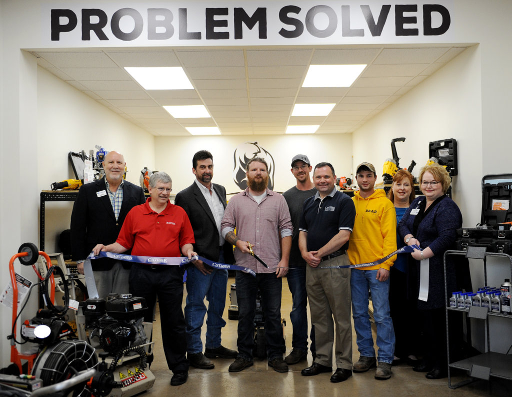 Bob Garrett, David Zartman, Tim Clark, Skyler Herb, Ryan Brezgel, Fred Gaffney, Cody Stine, Rep. Lynda Schlegel-Culver and Tea Jay Aikey cut the ribbon for Bear Rental.
