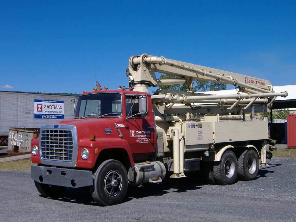 Zartman Construction has a Schwing Concrete pump rental.